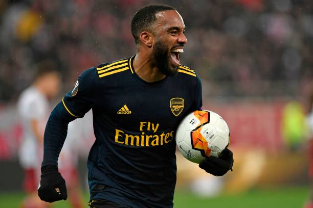 Arsenal's French striker Alexandre Lacazette celebrates after he scores the opening goal of the UEFA Europa League round of 32 first leg football match between Olympiakos and Arsenal at the Karaiskakis Stadium in Piraeus, near Athens, on February 20, 2020.