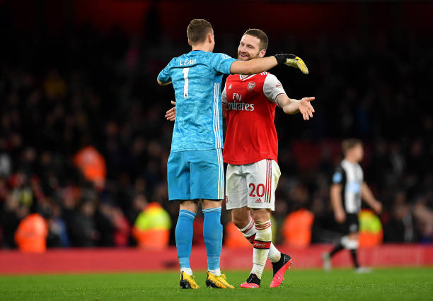 Bernd Leno and Shkodran Mustafi of Arsenal celebrate victory during the Premier League match between Arsenal FC and Newcastle United at Emirates Stadium on February 16, 2020 in London, United Kingdom.