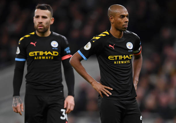 Fernandinho and Nicolas Otamendi of Manchester City show their disappointment during the Premier League match between Tottenham Hotspur and Manchester City at Tottenham Hotspur Stadium on February 02, 2020 in London, United Kingdom.
