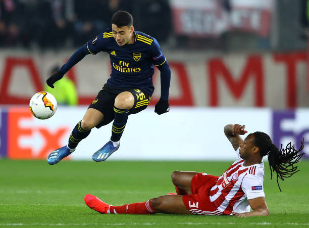 Gabriel Martinelli of Arsenal is challenged by Ruben Semedo of Olympiacos FC during the UEFA Europa League round of 32 first leg match between Olympiacos FC and Arsenal FC at Karaiskakis Stadium on February 20, 2020 in Piraeus, Greece.