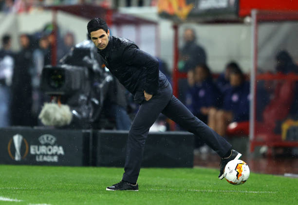 Mikel Arteta, Manager of Arsenal controls the ball during the UEFA Europa League round of 32 first leg match between Olympiacos FC and Arsenal FC at Karaiskakis Stadium on February 20, 2020 in Piraeus, Greece.