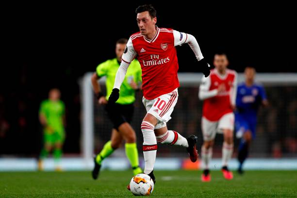 Arsenal's German midfielder Mesut Ozil runs with the ball during the UEFA Europa league round of 32 second leg football match between Arsenal and Olympiakos at the Emirates stadium in London on February 27, 2020.