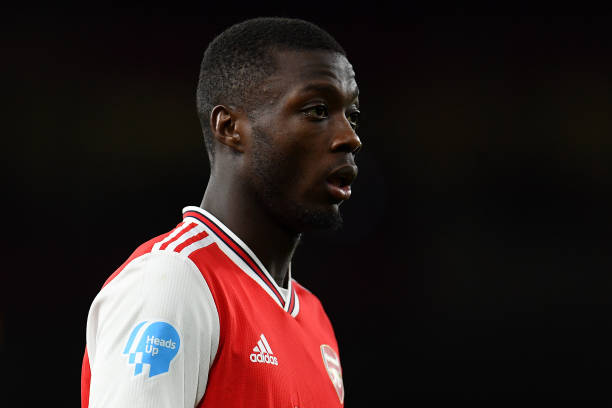 Nicolas Pepe of Arsenal with the Heads Up logo on his shirt during the Premier League match between Arsenal FC and Newcastle United at Emirates Stadium on February 16, 2020 in London, United Kingdom.