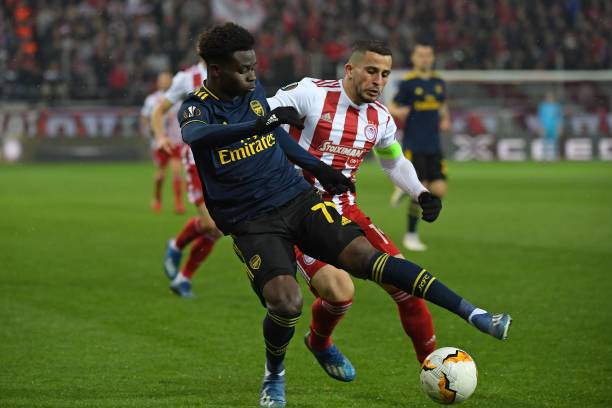 Arsenal's English striker Bukayo Saka (L) vies with Olympiakos' Norwegian defender Omar Elabdellaoui (R) during the UEFA Europa League round of 32 first leg football match between Olympiakos and Arsenal at the Karaiskakis Stadium in Piraeus, near Athens, on February 20, 2020.