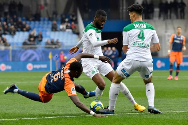 Montpellier's French defender Junior Sambia (L) fights for the ball with Saint-Etienne's French midfielder Jean-Eudes Aholou (C) and Saint-Etienne's French defender William Saliba (R) during the French L1 football match between Montpellier (MHSC) and Saint-Etienne (ASSE) on February 9, 2020 at the Mosson stadium in Montpellier, southern France.
