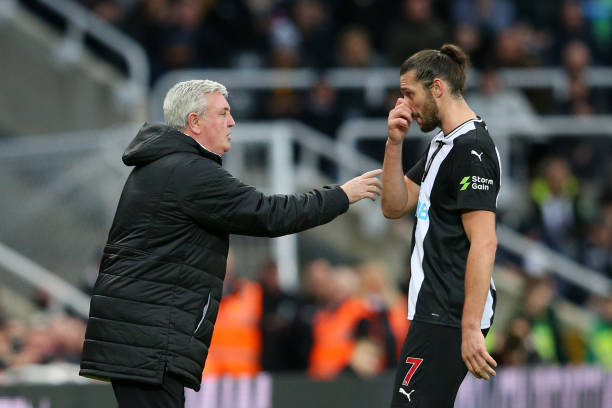 Steve Bruce, Manager of Newcastle United speaks to Andy Carroll of Newcastle United during the Premier League match between Newcastle United and Everton FC at St. James Park on December 28, 2019 in Newcastle upon Tyne, United Kingdom.