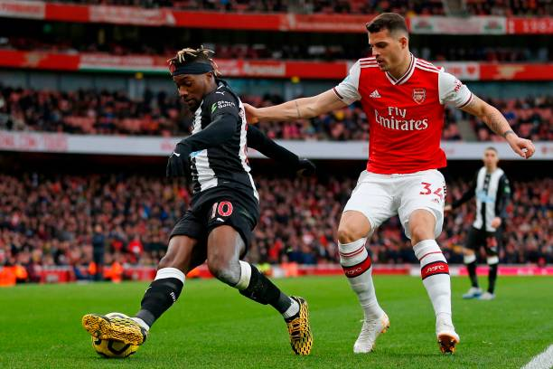 Newcastle United's French midfielder Allan Saint-Maximin (L) vies with Arsenal's Swiss midfielder Granit Xhaka (R) during the English Premier League football match between Arsenal and Newcastle United at the Emirates Stadium in London on February 16, 2020.