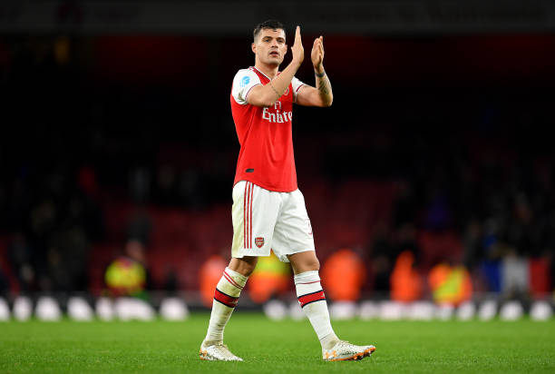 Granit Xhaka of Arsenal celebrates victory during the Premier League match between Arsenal FC and Newcastle United at Emirates Stadium on February 16, 2020 in London, United Kingdom.