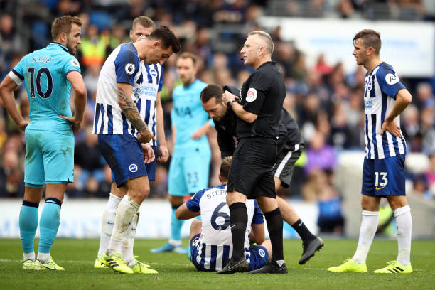 Referee Jonathan Moss talks to Lewis Dunk during the Premier League match between Brighton & Hove Albion and Tottenham Hotspur at American Express Community Stadium on October 05, 2019 in Brighton, United Kingdom.