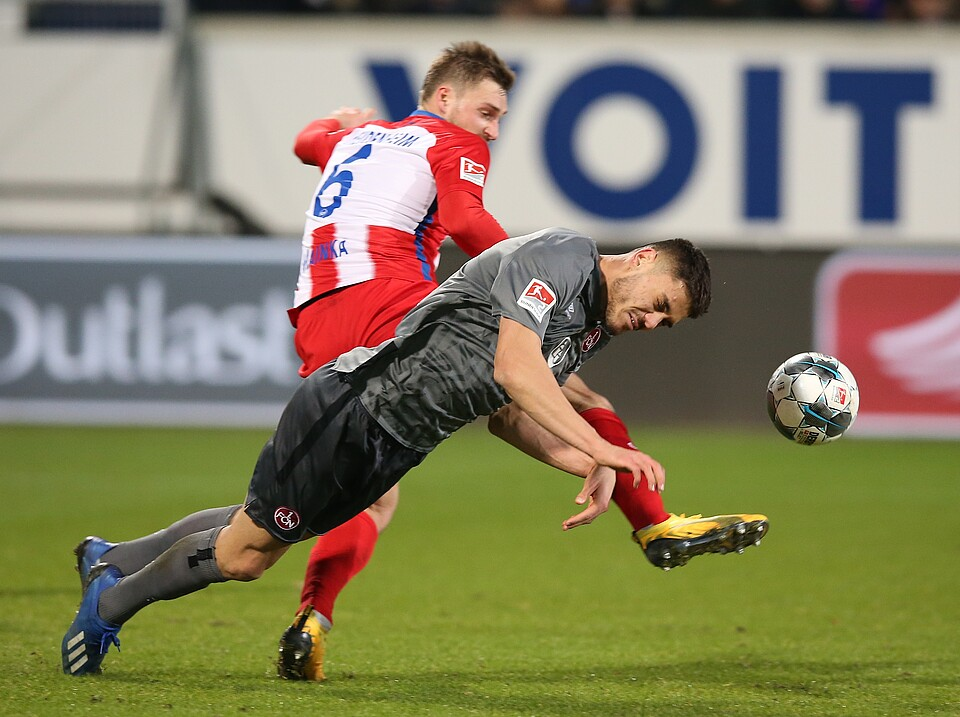 Konstantinos Mavropanos goes for the ball with FC Nürnberg (Photo via FCN.de)