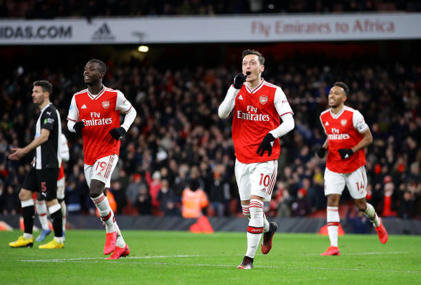 LONDON, ENGLAND - FEBRUARY 16: Mesut Ozil of Arsenal celebrates after scoring his sides third goal during the Premier League match between Arsenal FC and Newcastle United at Emirates Stadium on February 16, 2020 in London, United Kingdom. (Photo by Richard Heathcote/Getty Images)
