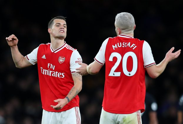 LONDON, ENGLAND - FEBRUARY 23: Granit Xhaka and Shkodran Mustafi of Arsenal in conversation at full-time during the Premier League match between Arsenal FC and Everton FC at Emirates Stadium on February 23, 2020 in London, United Kingdom. (Photo by Catherine Ivill/Getty Images)