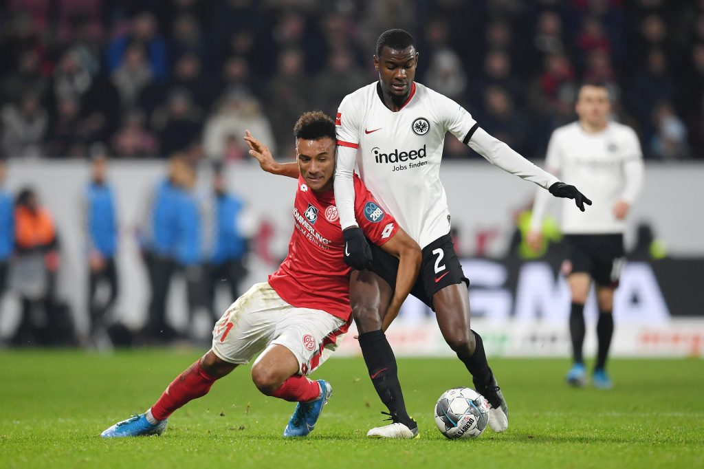 MAINZ, GERMANY - DECEMBER 02: Karim Onisiwo of 1. FSV Mainz 05 battles for possession with Evan Ndicka of Eintracht Frankfurt during the Bundesliga match between 1. FSV Mainz 05 and Eintracht Frankfurt at Opel Arena on December 02, 2019, in Mainz, Germany. (Photo by Matthias Hangst/Bongarts/Getty Images)