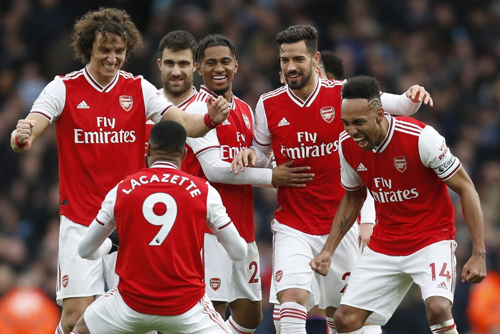 Arsenal's French striker Alexandre Lacazette (C) celebrates with teammates after scoring the opening goal of the English Premier League football match between Arsenal and West Ham at the Emirates Stadium in London on March 7, 2020.