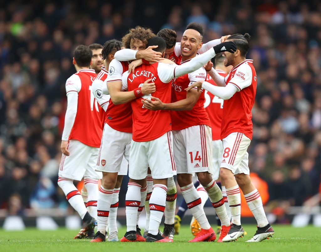 Alexandre Lacazette of Arsenal celebrates with teammates after scoring his team's first goal which was given by VAR during the Premier League match between Arsenal FC and West Ham United at Emirates Stadium on March 07, 2020 in London, United Kingdom.