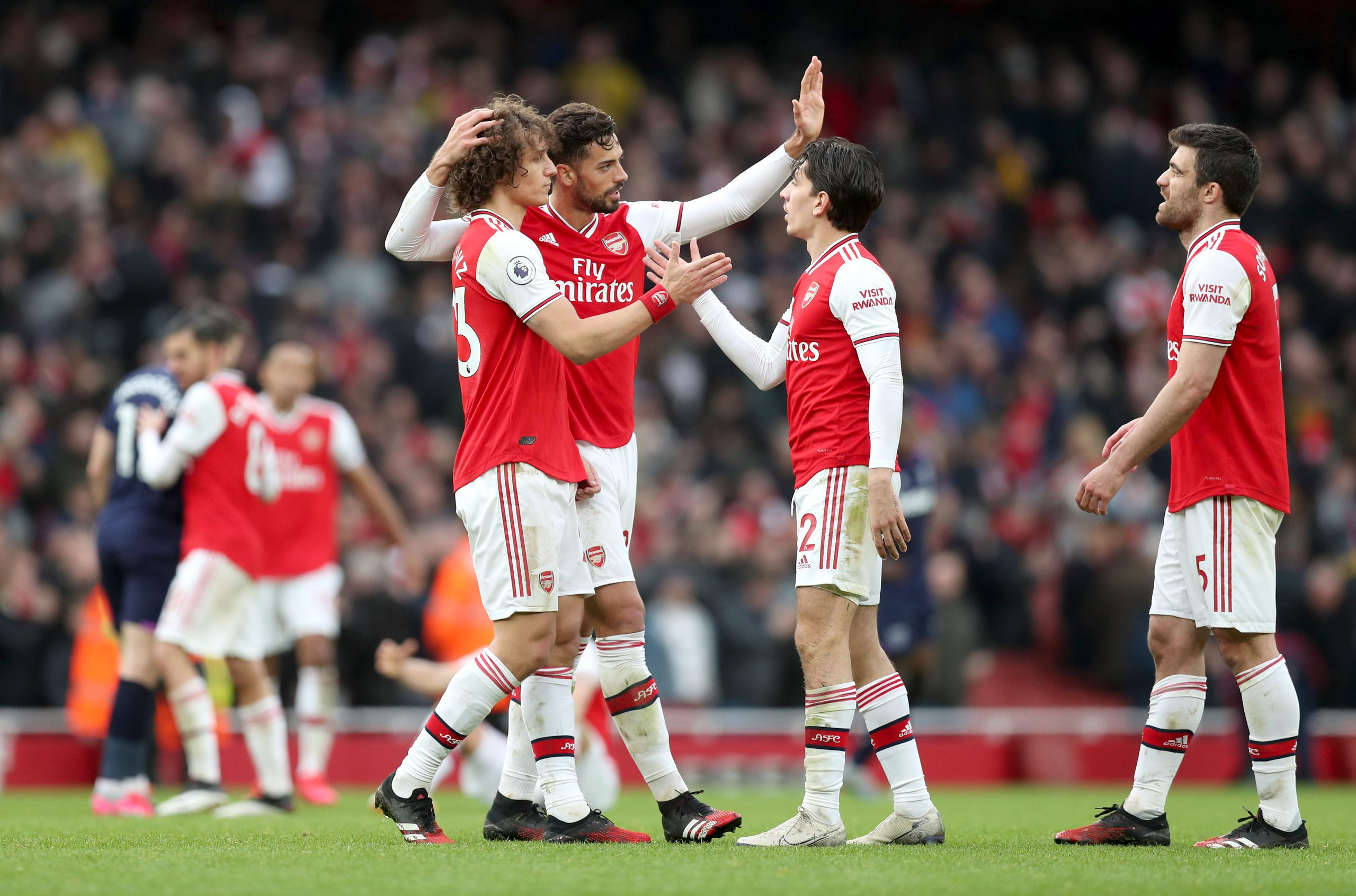 Players of Arsenal celebrate following the Premier League match between Arsenal FC and West Ham United at Emirates Stadium on March 07, 2020 in London, United Kingdom.