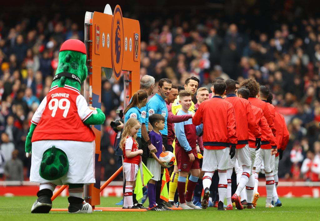 Players of Arsenal and West Ham United give each other a fist bump instead of a handshake prior to the Premier League match between Arsenal FC and West Ham United at Emirates Stadium on March 07, 2020 in London, United Kingdom.
