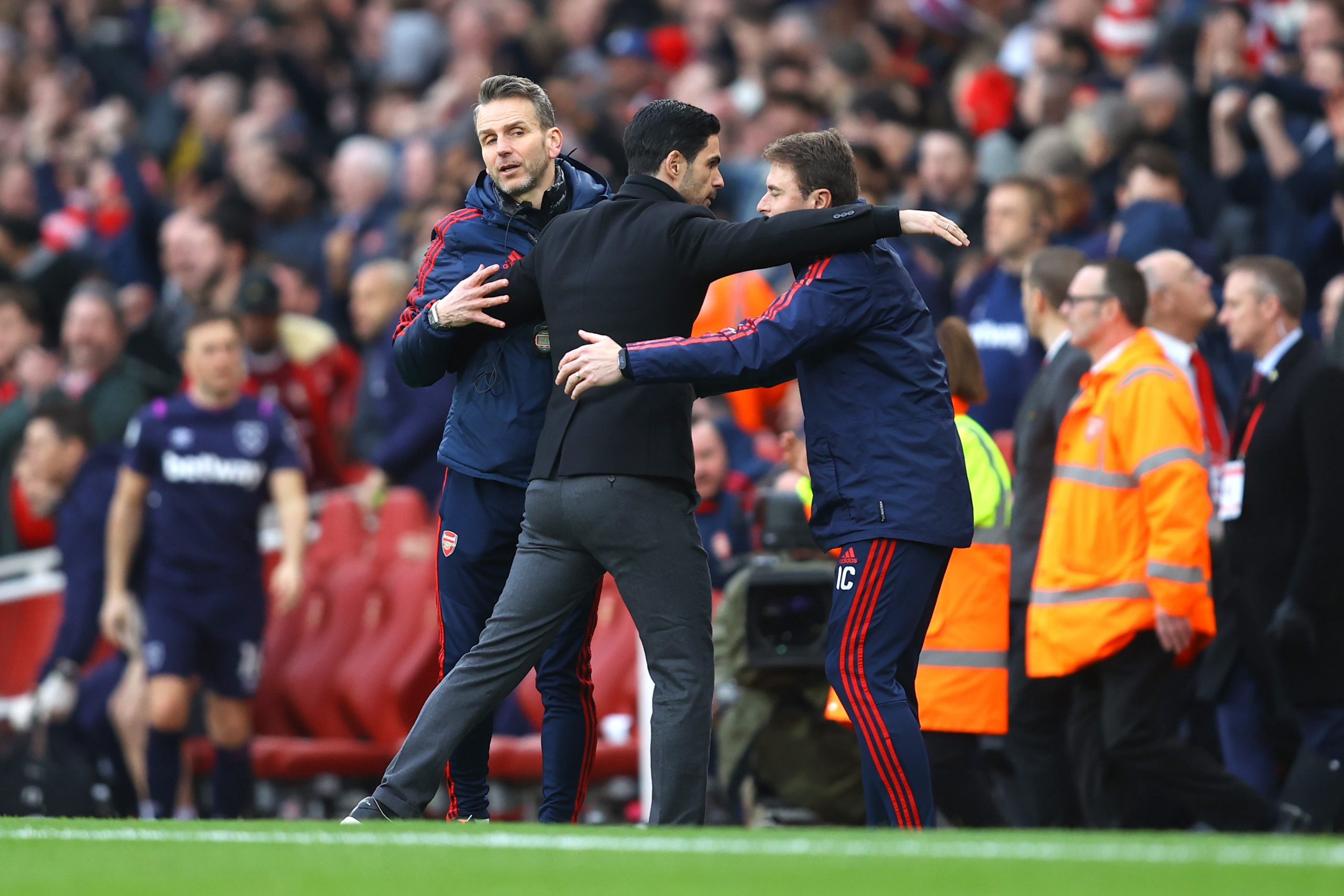 Mikel Arteta, Manager of Arsenal embraces his coaching staff following his sides victory in the Premier League match between Arsenal FC and West Ham United at Emirates Stadium on March 07, 2020 in London, United Kingdom.
