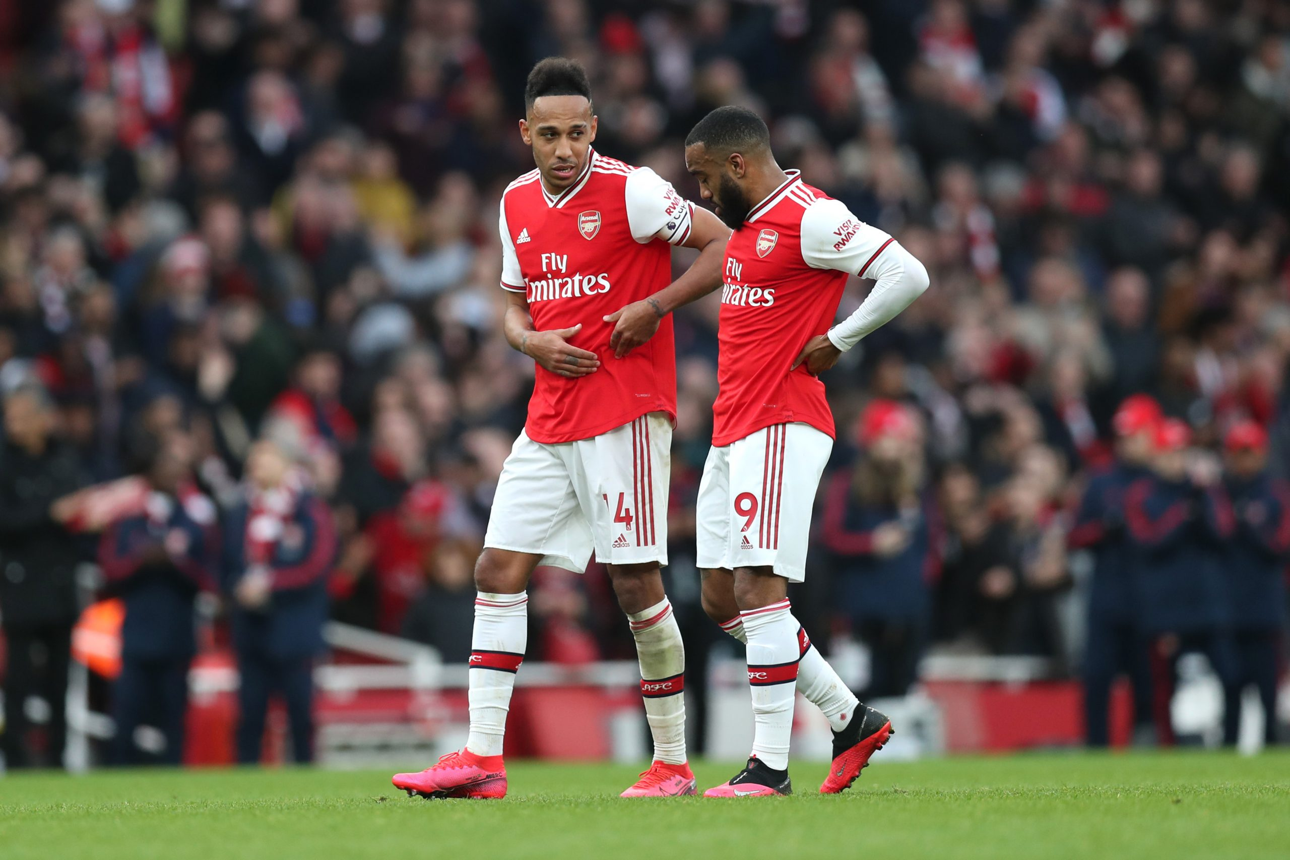 Pierre-Emerick Aubameyang and Alexandre Lacazette of Arsenal talk following their sides victory in the Premier League match between Arsenal FC and West Ham United at Emirates Stadium on March 07, 2020 in London, United Kingdom.
