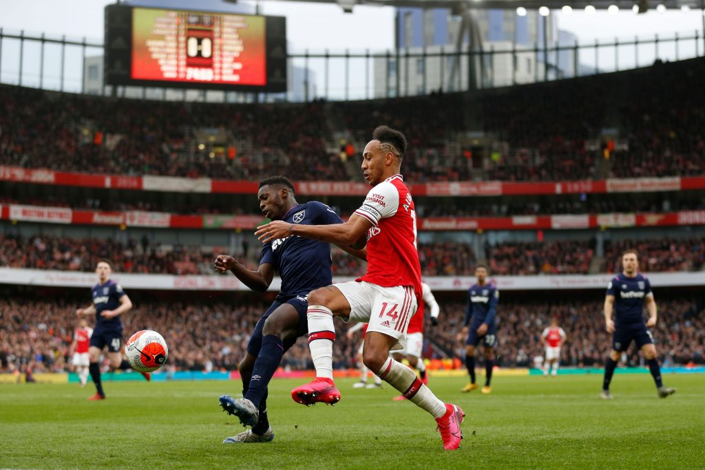 West Ham United's English midfielder Jeremy Ngakia (centre left) vies with Arsenal's Gabonese striker Pierre-Emerick Aubameyang during the English Premier League football match between Arsenal and West Ham at the Emirates Stadium in London on March 7, 2020.