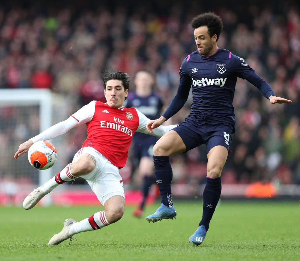 Felipe Anderson of West Ham United is challenged by Hector Bellerin of Arsenal during the Premier League match between Arsenal FC and West Ham United at Emirates Stadium on March 07, 2020 in London, United Kingdom.