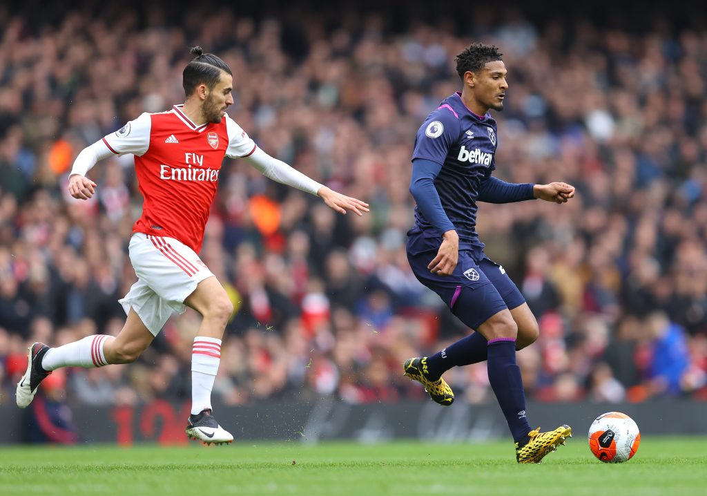 Sebastien Haller of West Ham United is challenged by Dani Ceballos of Arsenal during the Premier League match between Arsenal FC and West Ham United at Emirates Stadium on March 07, 2020 in London, United Kingdom.