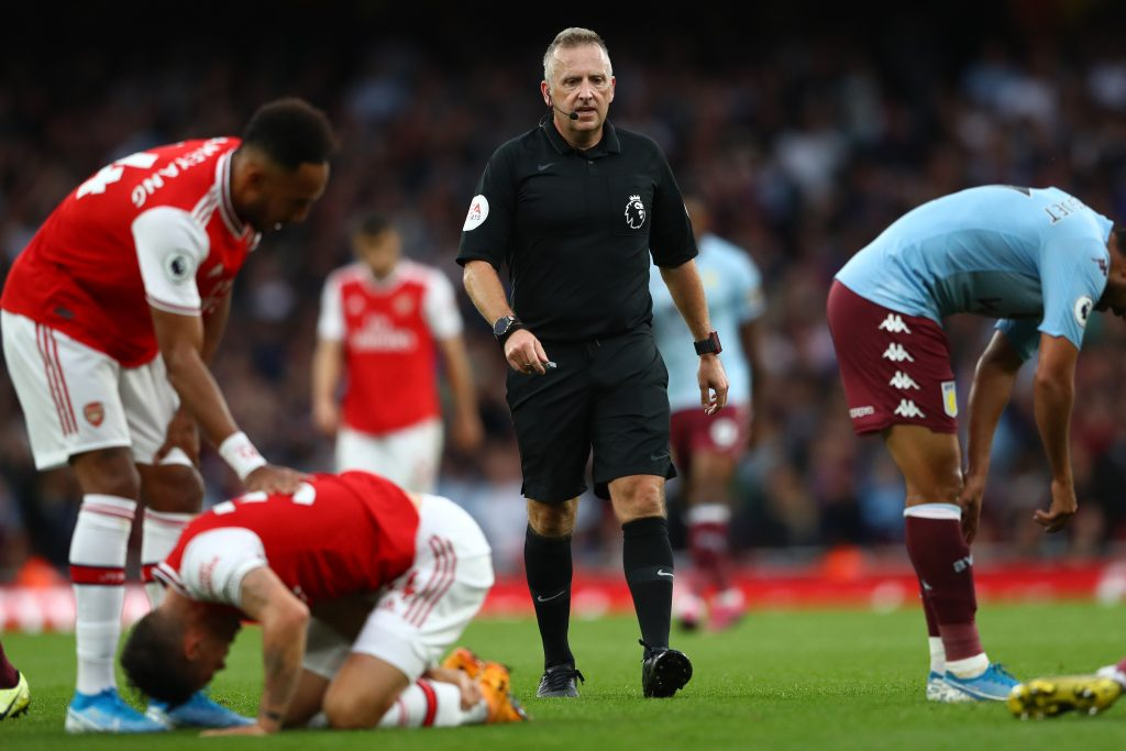 Referee Jon Moss looks on during the Premier League match between Arsenal FC and Aston Villa at Emirates Stadium on September 22, 2019 in London, United Kingdom.