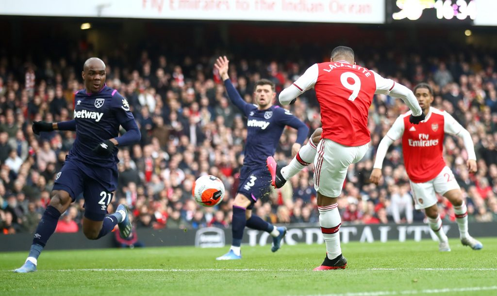 Alexandre Lacazette of Arsenal scores his team's first goal during the Premier League match between Arsenal FC and West Ham United at Emirates Stadium on March 07, 2020 in London, United Kingdom.