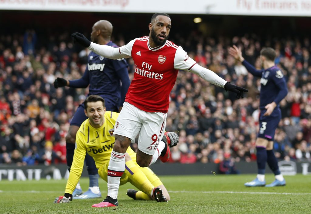Arsenal's French striker Alexandre Lacazette celebrates after scoring the opening goal of the English Premier League football match between Arsenal and West Ham at the Emirates Stadium in London on March 7, 2020.