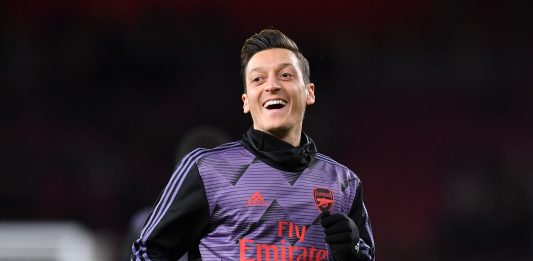 Arsenal's German midfielder Mesut Ozil warms up for the English Premier League football match between Arsenal and Manchester City at the Emirates Stadium in London on December 15, 2019.