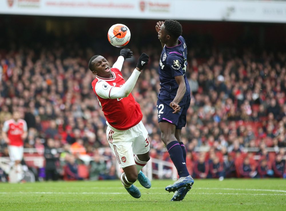 Eddie Nketiah of Arsenal is challenged in the penalty box by Jeremy Ngakia of West Ham United an incident which was later checked by VAR during the Premier League match between Arsenal FC and West Ham United at Emirates Stadium on March 07, 2020 in London, United Kingdom.