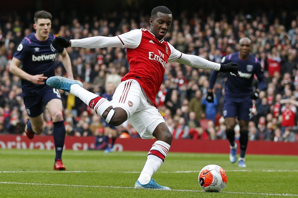 Arsenal's English striker Eddie Nketiah crosses the ball during the English Premier League football match between Arsenal and West Ham at the Emirates Stadium in London on March 7, 2020.