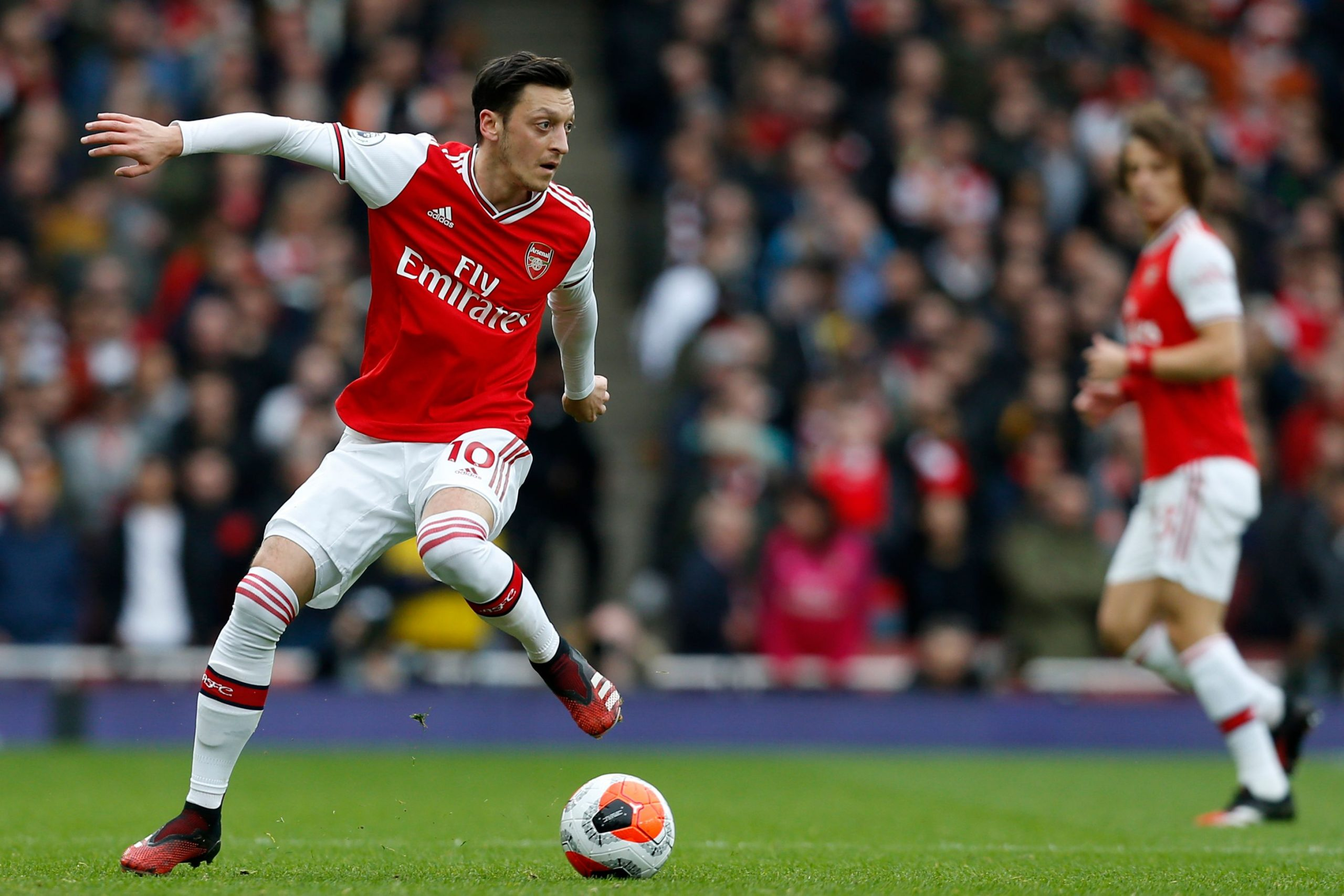 Arsenal's German midfielder Mesut Ozil controls the ball during the English Premier League football match between Arsenal and West Ham at the Emirates Stadium in London on March 7, 2020.