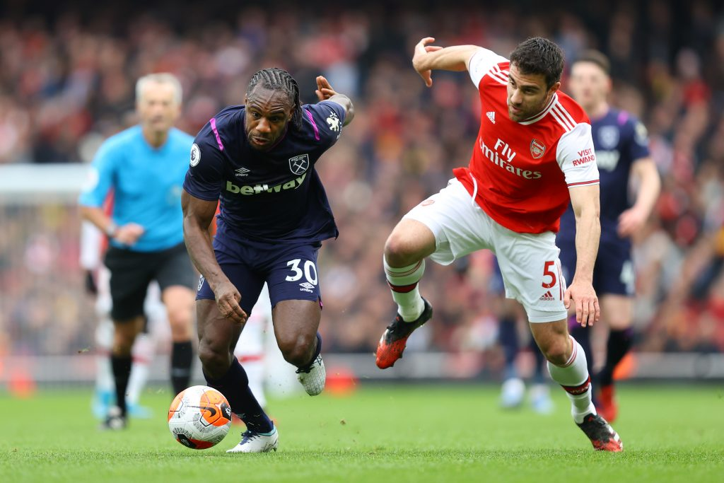 Michail Antonio of West Ham United battles for possession with Sokratis Papastathopoulos of Arsenal during the Premier League match between Arsenal FC and West Ham United at Emirates Stadium on March 07, 2020 in London, United Kingdom.