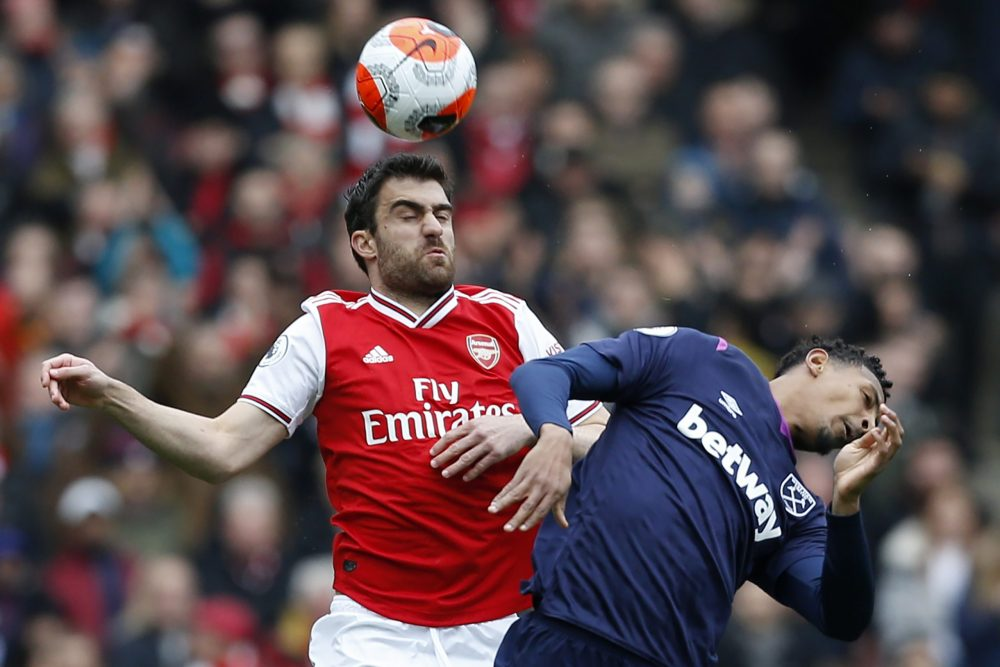 Arsenal's Greek defender Sokratis Papastathopoulos (L) vies with West Ham United's French striker Sebastien Haller (R) during the English Premier League football match between Arsenal and West Ham at the Emirates Stadium in London on March 7, 2020.