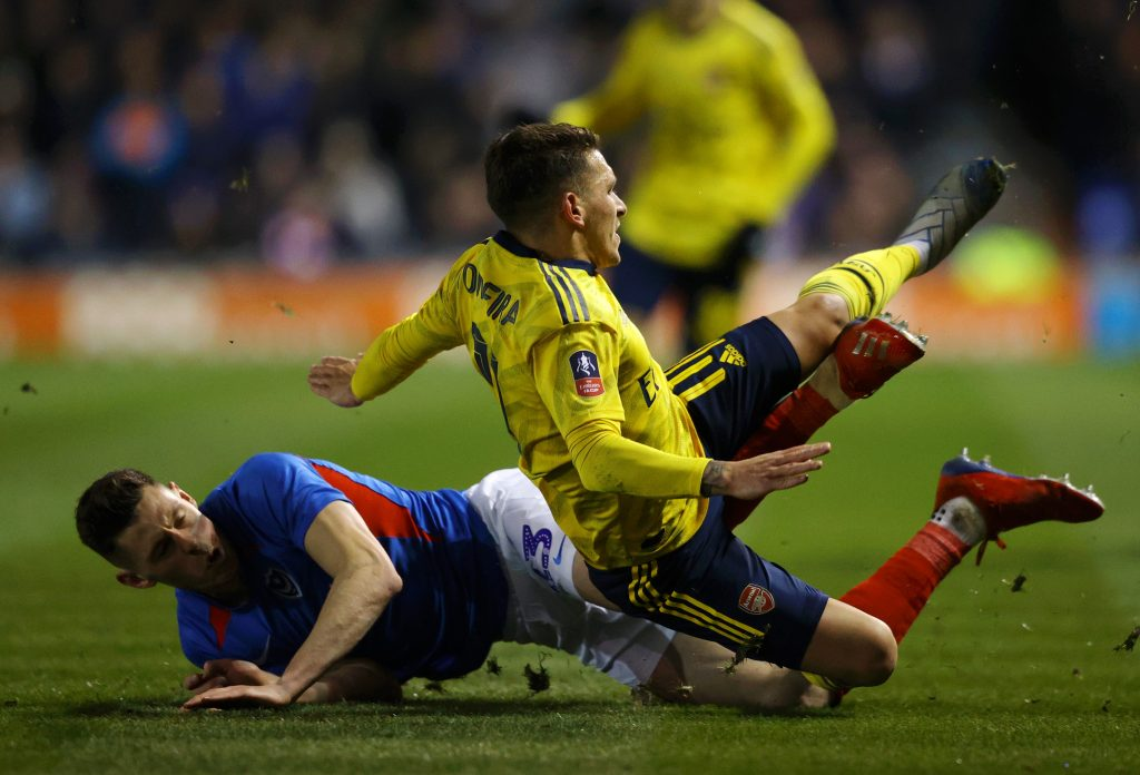 Lucas Torreira of Arsenal is tackled by James Bolton of Portsmouth FC which leads to Lucas Torreira being stretchered off due to injury during the FA Cup Fifth Round match between Portsmouth FC and Arsenal FC at Fratton Park on March 02, 2020 in Portsmouth, England.