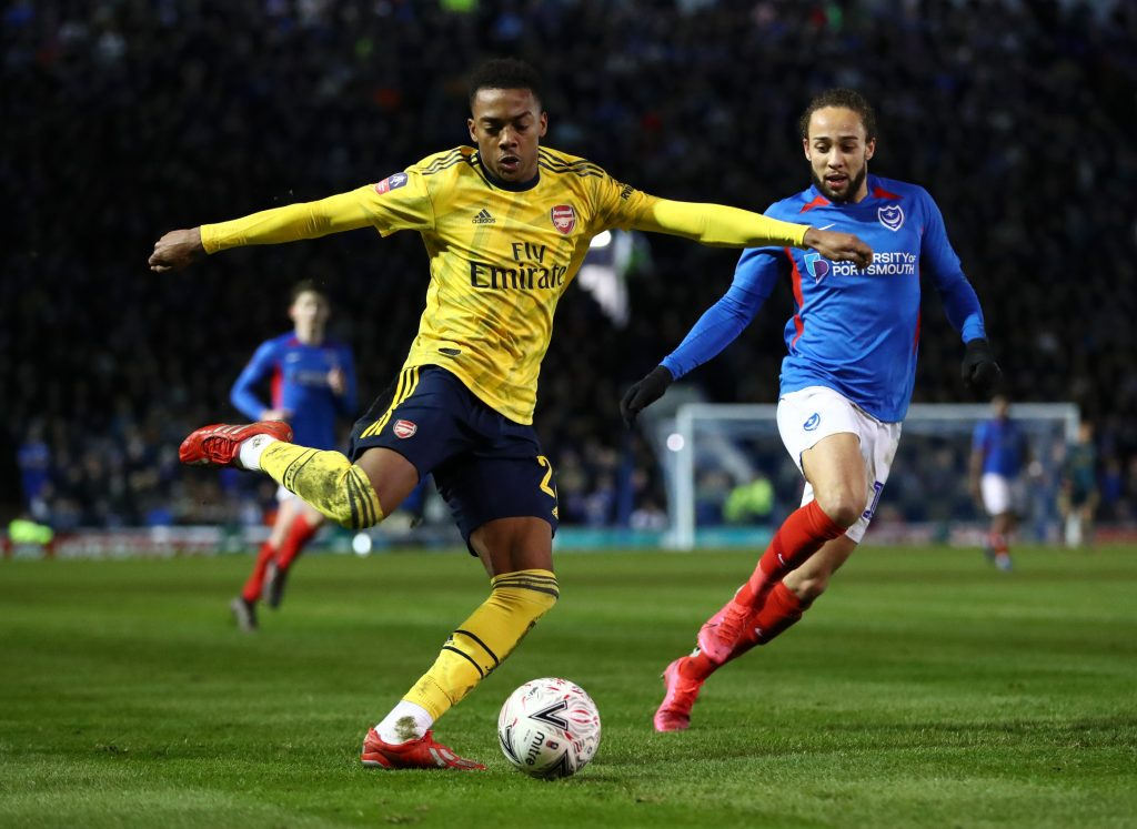 Joe Willock of Arsenal battles for possession with Marcus Harness of Portsmouth FC during the FA Cup Fifth Round match between Portsmouth FC and Arsenal FC at Fratton Park on March 02, 2020 in Portsmouth, England.