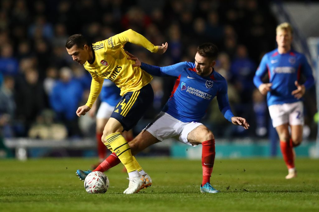 Granit Xhaka of Arsenal battles for possession with Ben Close of Portsmouth FC during the FA Cup Fifth Round match between Portsmouth FC and Arsenal FC at Fratton Park on March 02, 2020 in Portsmouth, England.