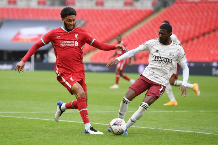 LONDON, ENGLAND - AUGUST 29: Joe Gomez of Liverpool battles for possession with Ainsley Maitland-Niles of Arsenal during the FA Community Shield final between Arsenal and Liverpool at Wembley Stadium on August 29, 2020 in London, England. (Photo by Justin Tallis/ pool via Getty Images)