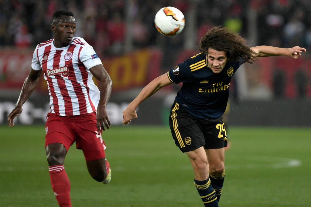 Arsenal's French midfielder Matteo Guendouzi (R) vies with Olympiakos' Guinean midfielder Mohamed Mady Camara (L) during the UEFA Europa League round of 32 first leg football match between Olympiakos and Arsenal at the Karaiskakis Stadium in Piraeus, near Athens, on February 20, 2020. (Photo by LOUISA GOULIAMAKI / AFP via Getty Images)