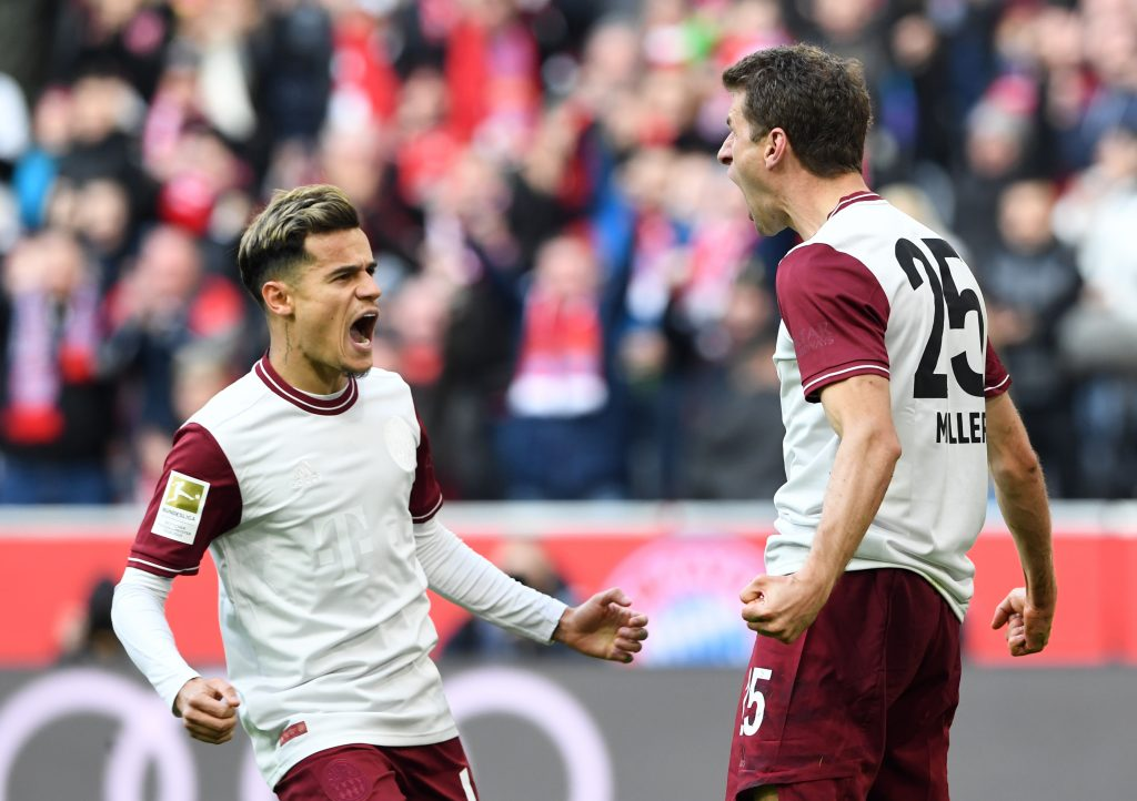 Bayern Munich's striker Thomas Mueller (R) and on-loan Bayern Munich midfielder Philippe Coutinho (L). Photo during the Bundesliga match between FC Bayern Munich and FC Augsburg, on March 8, 2020. (Photo by Christof STACHE / AFP via Getty Images)