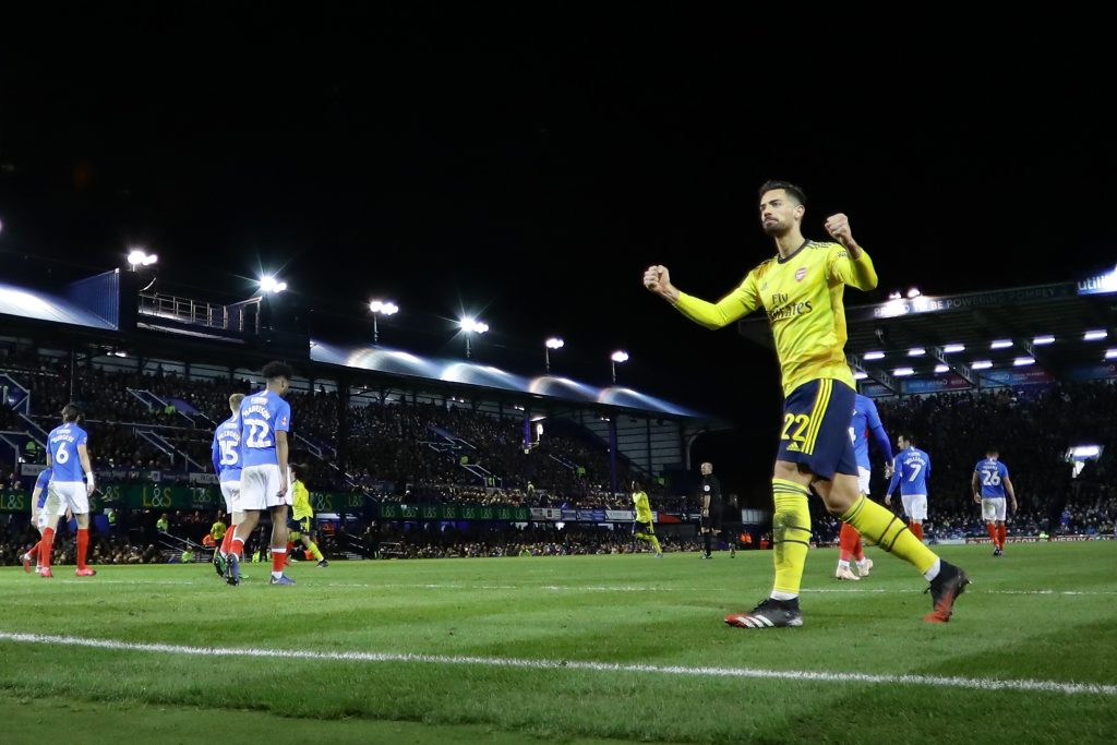 PORTSMOUTH, ENGLAND - MARCH 02: Pablo Mari of Arsenal celebrates after his teammate Sokratis Papastathopoulos of Arsenal (not pictured) scored their team's first goal during the FA Cup Fifth Round match between Portsmouth FC and Arsenal FC at Fratton Park on March 02, 2020 in Portsmouth, England. (Photo by Richard Heathcote/Getty Images)