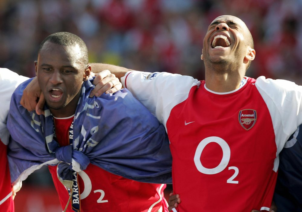 Arsenal's Invincibles LONDON, UNITED KINGDOM: Arsenal's Patrick Vieira (L) and Thierry Henry celebrate after winning the Premiership title and defeating Leicsester City 15 May, 2004 at Highbury in London. Arsenal defeated Leicester City 2-1 and finish the season undefeated. AFP PHOTO/JIM WATSON (Photo credit should read JIM WATSON/AFP via Getty Images)