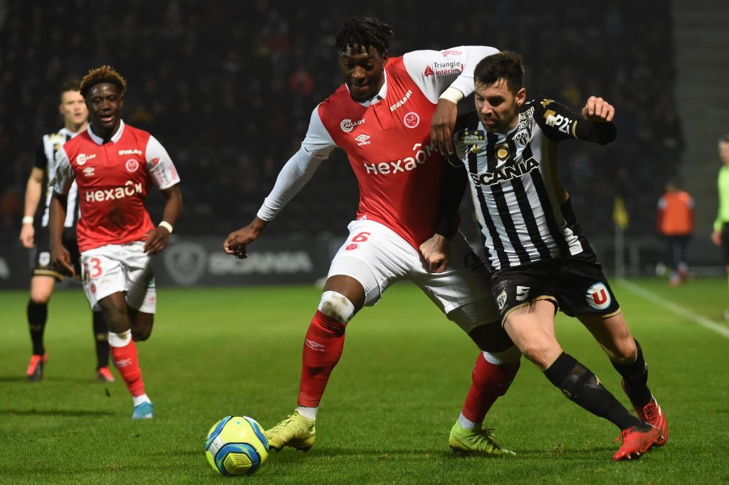 Reims' French defender Axel Disasi (C) vies with Angers' French midfielder Thomas Mangani (R) during the French L1 football match between Angers (SCO) and Reims (SR) on Febuary 1, 2020, at the Raymond-Kopa Stadium in Angers, northwestern France. (Photo by JEAN-FRANCOIS MONIER/AFP via Getty Images)