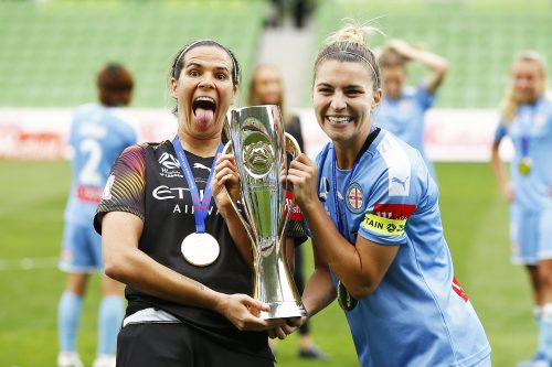 MELBOURNE, AUSTRALIA - MARCH 21: Melbourne City goalkeeper Lydia Williams (L) and Steph Catley of Melbourne City pose with the trophy after winning the 2020 W-League Grand Final match between Melbourne City and Sydney FC at AAMI Park on March 21, 2020 in Melbourne, Australia. (Photo by Daniel Pockett/Getty Images)