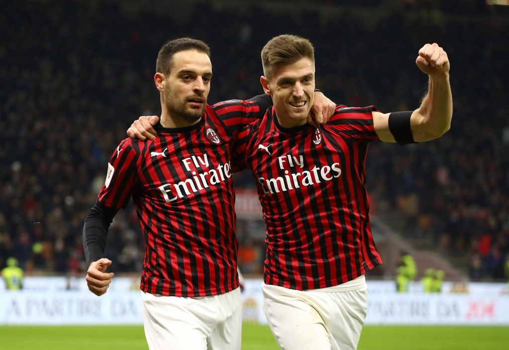 MILAN, ITALY - JANUARY 28:  Giacomo Bonaventura (L) of AC Milan celebrates with his team-mate Krzysztof Piatek (R) after scoring the opening goal during the Coppa Italia Quarter Final match between AC Milan and Torino at San Siro on January 28, 2020 in Milan, Italy.  (Photo by Marco Luzzani/Getty Images)