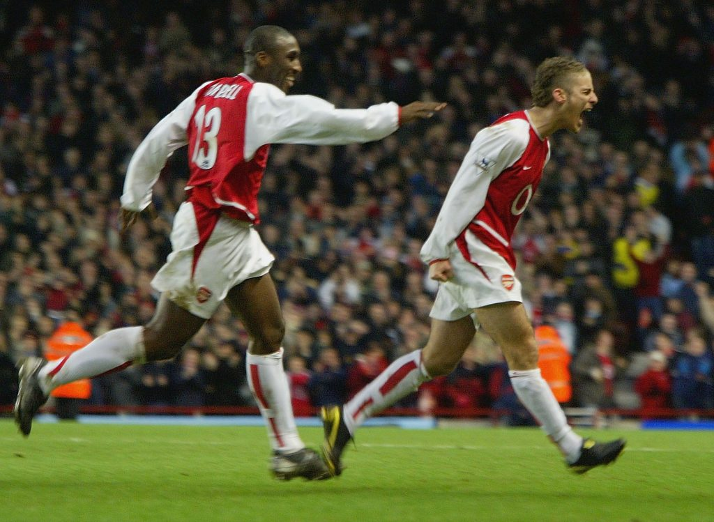 LONDON - JANUARY 24: David Bentley of Arsenal celebrates scoring their fourth goal during the FA Cup Fourth round match between Arsenal and Middlesbrough at Highbury on January 24, 2004 in London. (Photo by Clive Rose/Getty Images)