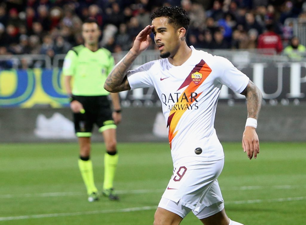 CAGLIARI, ITALY - MARCH 01: Justin Kluivert of Roma celebrates his goal 1-3 during the Serie A match between Cagliari Calcio and AS Roma at Sardegna Arena on March 1, 2020 in Cagliari, Italy. (Photo by Enrico Locci/Getty Images)