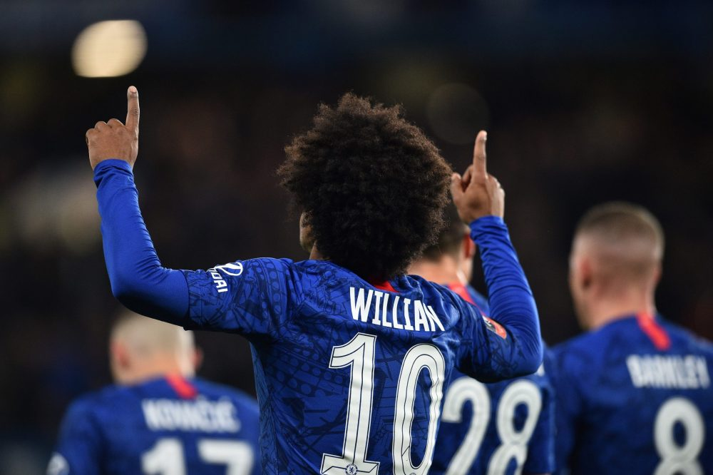 Chelsea's Brazilian midfielder Willian celebrates scoring the opening goal during the English FA Cup fifth round football match between Chelsea and Liverpool at Stamford Bridge in London on March 3, 2020. (Photo by Glyn KIRK / AFP)