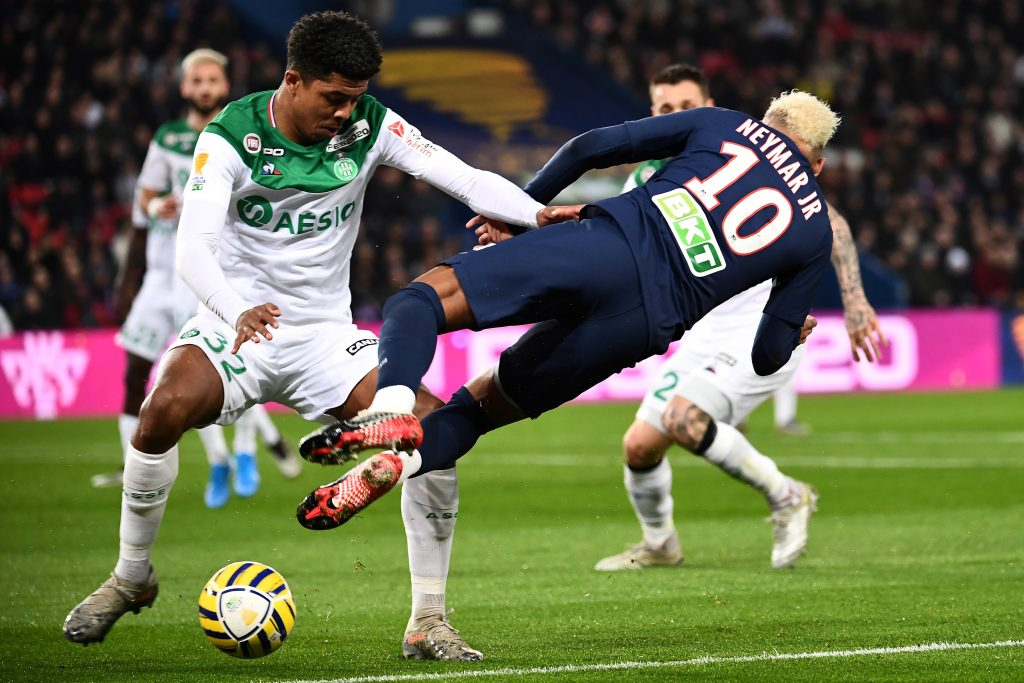 Paris Saint-Germain's Brazilian forward Neymar (R) falls as he vies for the ball with Saint-Etienne's French defender Wesley Fofana (L) during the French League cup final quarter match between Paris Saint-Germain (PSG) and AS Saint Etienne at the Parc des Princes stadium in Paris on January 8, 2020. (Photo by Anne-Christine POUJOULAT / AFP) (Photo by ANNE-CHRISTINE POUJOULAT/AFP via Getty Images)